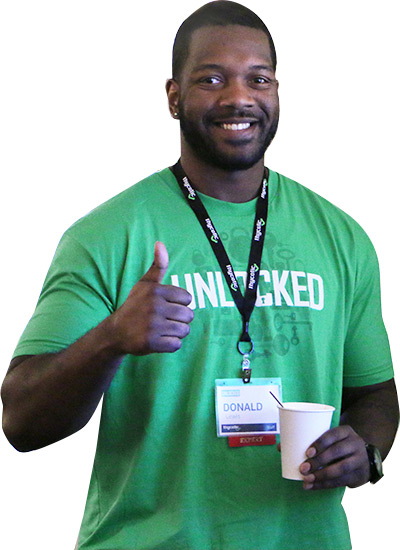 UNLOCKED attendee gives thumbs up