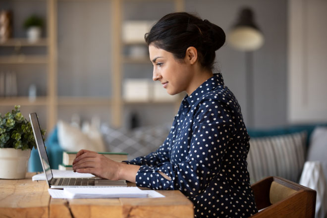 Woman on laptop oversees services accounts